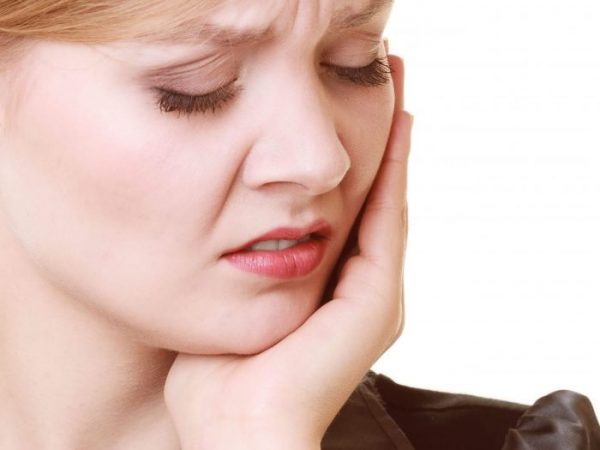 An impacted tooth can grow inwards towards other teeth causing pain and even fractures.v