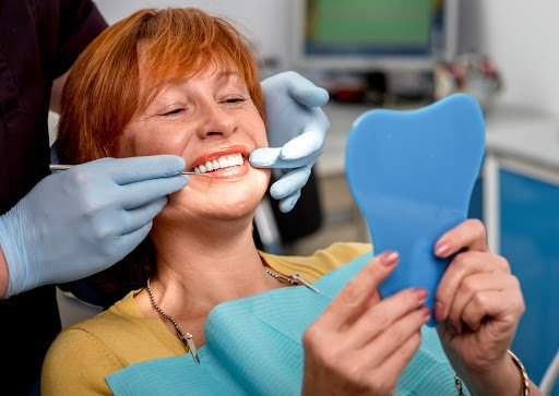 The denture is held in place by dental implants.